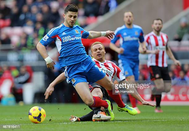 Shane Long of Hull City is brought down by Wes Brown of Sunderland leading to the Sunderland player being sent off during the Barclays Premier League...