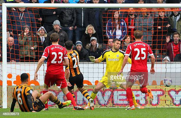 Shane Long of Hull City scores the second goal during the Barclays Premier League match between Hull City and West Bromwich Albion at the KC Stadium...