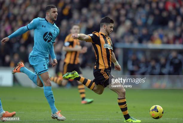 Shane Long of Hull City shoots to score the opening goal during the Barclays Premier League match between Hull City and Tottenham Hotspur at KC...