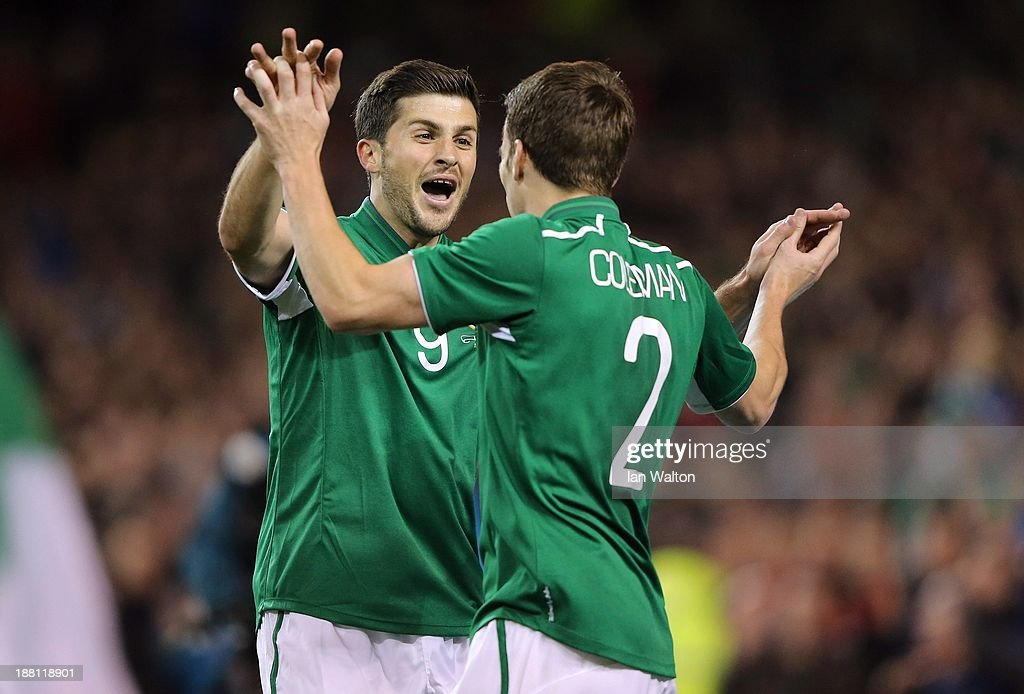 Shane Long (L) of Ireland celebrates scoring a goal with Seamus Coleman during the International Friendly match between Republic of Ireland and Latvia at Aviva Stadium on November 15, 2013 in Dublin, Ireland.