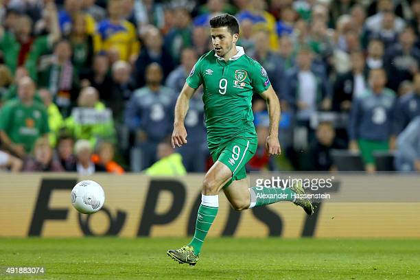 Shane Long of Ireland runs with the ball during the UEFA EURO 2016 Qualifier group D match between Republic of Ireland and Germany at the Aviva...
