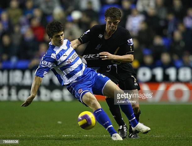 Shane Long of Reading battles with Hermann Hreidarsson of Portsmouth during the Barclays Premier League match between Reading and Portsmouth at the...