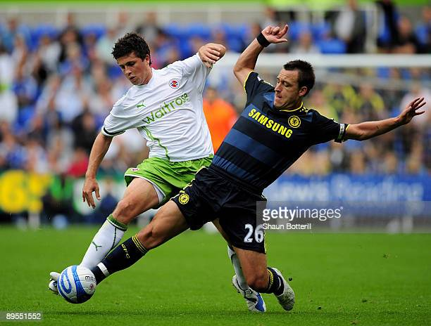 Shane Long of Reading is tackled by John Terry of Chelsea during the preseason friendly match between Reading and Chelsea at the Madejski Stadium on...