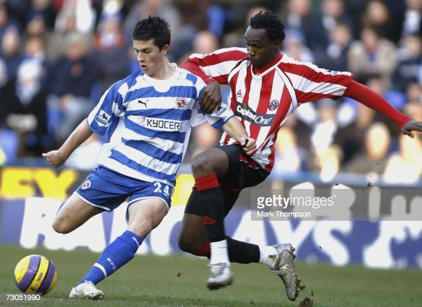 Shane Long of Reading tangles with Claude Davis of Sheffield United during the Barclays Premiership match between Reading and Sheffield United at the...