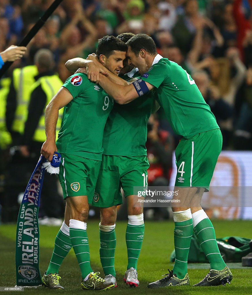 Shane Long of Republic of Ireland celebrates scoring the opening goal with Robbie Brady and John O'Shea of Republic of Ireland during the UEFA EURO 2016 Qualifier group D match between Republic of Ireland and Germany at the Aviva Stadium on October 8, 2015 in Dublin, Ireland.