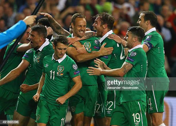Shane Long of Republic of Ireland celebrates scoring the opening goal team mates during the UEFA EURO 2016 Qualifier group D match between Republic...