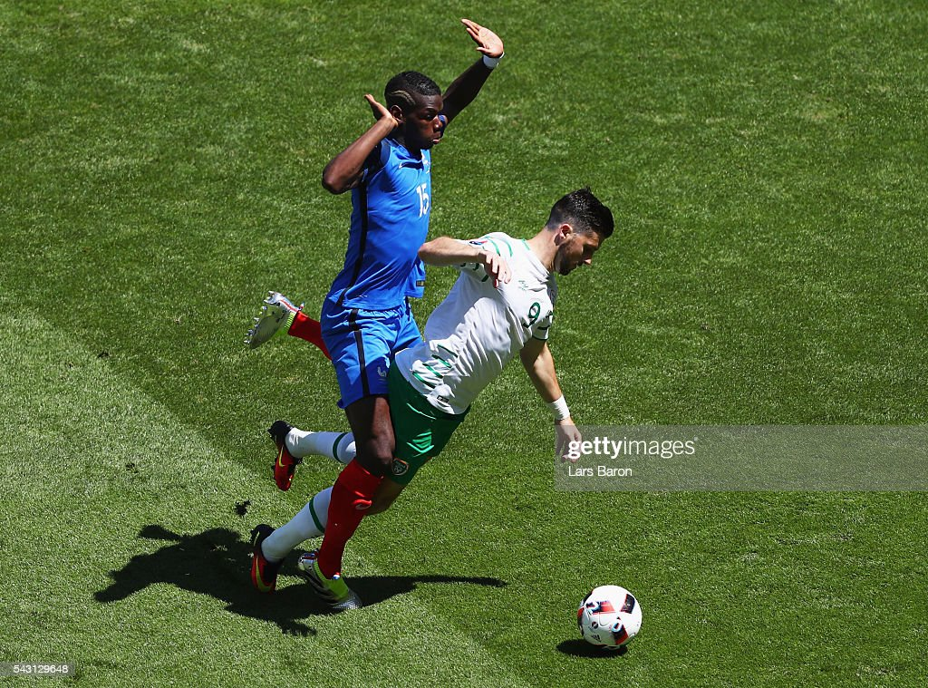 Shane Long of Republic of Ireland is challenged by Paul Pogba of France resulting in a penalty kick during the UEFA EURO 2016 round of 16 match between France and Republic of Ireland at Stade des Lumieres on June 26, 2016 in Lyon, France.
