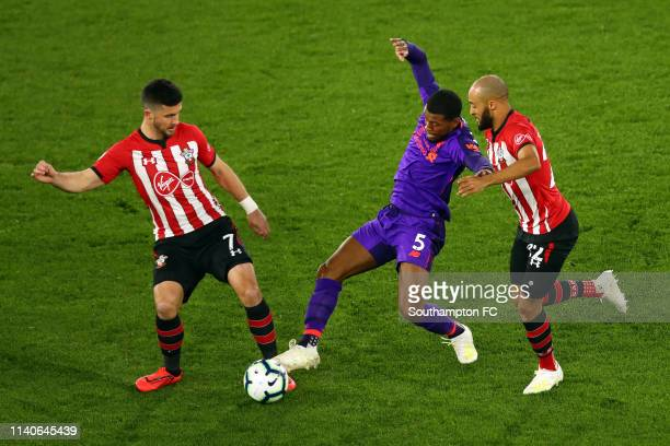 Shane Long of Southampton and Nathan Redmond of Southampton battles for possession with Georginio Wijnaldum of Liverpool during the Premier League...