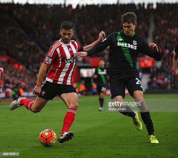 Shane Long of Southampton and Philipp Wollscheid of Stoke City compete for the ball during the Barclays Premier League match between Southampton and...