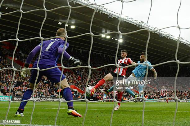 Shane Long of Southampton beats Nicolas Otamendi and Joe Hart of Manchester City as he scores the opening goal during the Barclays Premier League...
