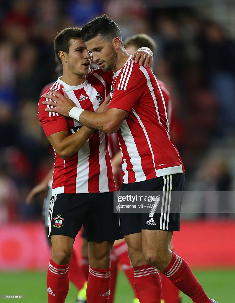 Shane Long of Southampton celebrates after he scores to make it 3-0 with Cedric Soares of Southampton during the UEFA Europa League Qualifier between Southampton and Vitesse at St Mary's Stadium on July 30, 2015 in Southampton, England.