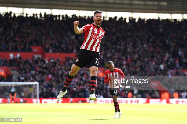 Shane Long of Southampton celebrates after scoring his team's first goal during the Premier League match between Southampton FC and AFC Bournemouth...