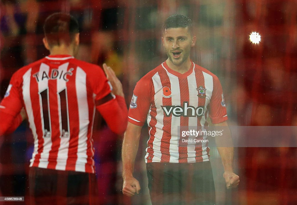 Shane Long of Southampton celebrates scoring a goal with Dusan Tadic of Southampton during the Barclays Premier League match between Southampton and Leicester City at St Mary's Stadium on November 8, 2014 in Southampton, England.