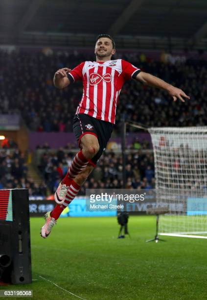 Shane Long of Southampton celebrates scoring his side's first goal during the Premier League match between Swansea City and Southampton at Liberty...