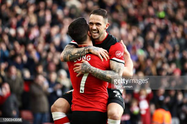 Shane Long of Southampton celebrates scoring his sides second goal with teammate Danny Ings during the Premier League match between Southampton FC...