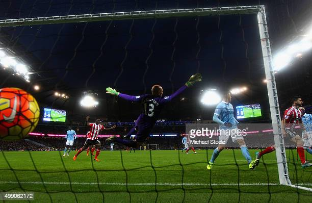 Shane Long of Southampton celebrates scoring his team's first goal past Wilfredo Caballero of Manchester City during the Barclays Premier League...