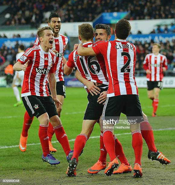 Shane Long of Southampton celebrates scoring his team's first goal with his team matesduring the Barclays Premier League match between Swansea City...