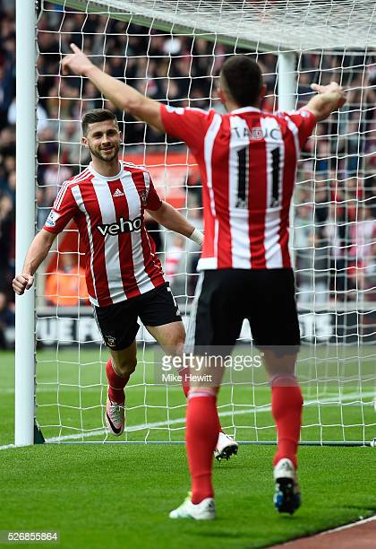 Shane Long of Southampton celebrates scoring the opening goal during the Barclays Premier League match between Southampton and Manchester City at St...