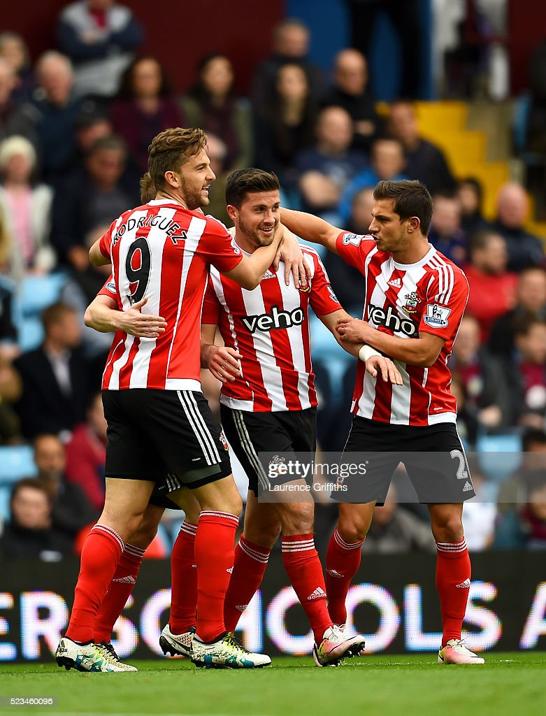 Shane Long of Southampton celebrates with Jay Rodriguez of Southampton and Cedric Soares of Southampton after scoring the opening goal during the Barclays Premier League match between Aston Villa and Southampton at Villa Park on April 23, 2016 in Birmingham, United Kingdom.