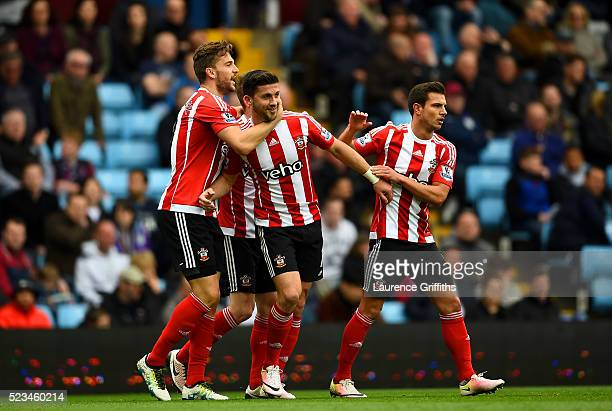 Shane Long of Southampton celebrates with Jay Rodriguez of Southampton and Cedric Soares of Southampton after scoring the opening goal during the...