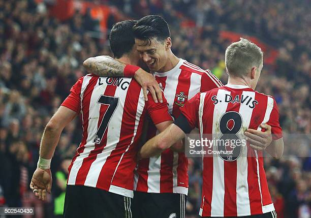 Shane Long of Southampton celebrates with Jose Fonte and Steven Davis as he scores their fourth goal during the Barclays Premier League match between...