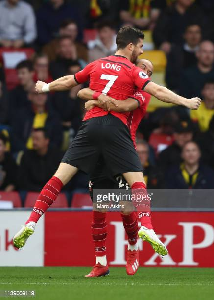 Shane Long of Southampton celebrates with Nathan Redmond during the Premier League match between Watford FC and Southampton FC at Vicarage Road on...