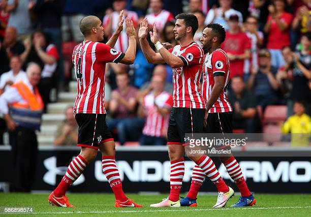 Shane Long of Southampton celebrates with Oriol Romeu of Southampton after scoring his sides first goal during the pre-season friendly between...