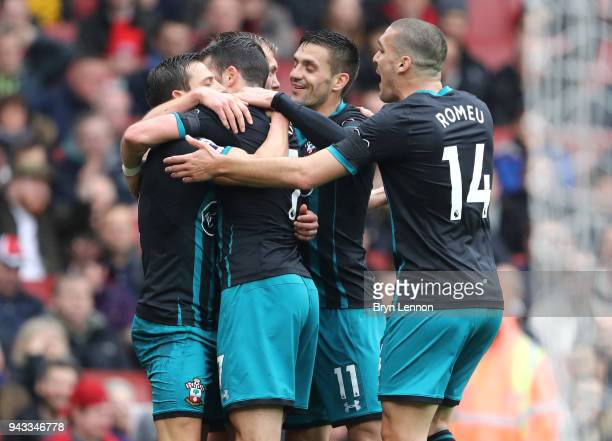 Shane Long of Southampton celebrates with team mates after scoring his sides first goal during the Premier League match between Arsenal and...