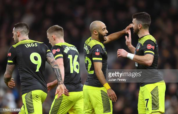 Shane Long of Southampton celebrates with teammate Nathan Redmond of Southampton after scoring their teams first goal during the FA Cup Fourth Round...