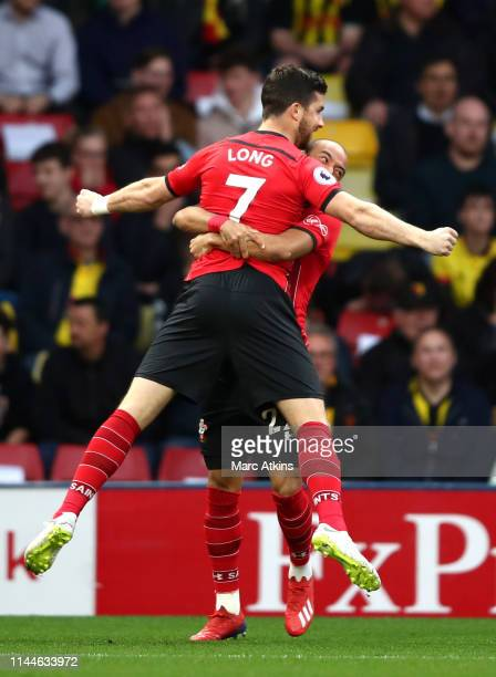 Shane Long of Southampton celebrates with teammate Nathan Redmond after scoring his team's first goal during the Premier League match between Watford...