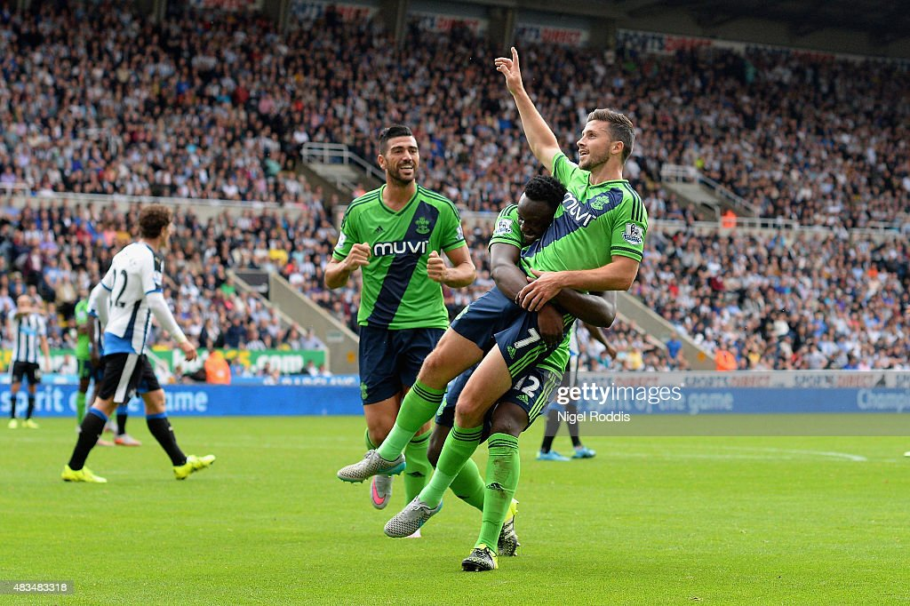 Shane Long of Southampton (7) celebrates with Victor Wanyama (12) and Graziano Pelle (L) as he scores their second goal during the Barclays Premier League match between Newcastle United and Southampton at St James' Park on August 9, 2015 in Newcastle upon Tyne, England.