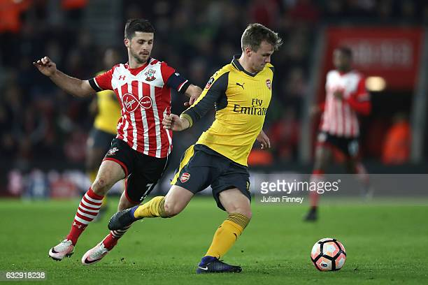 Shane Long of Southampton chases down Rob Holding of Arsenal during the Emirates FA Cup Fourth Round match between Southampton and Arsenal at St...