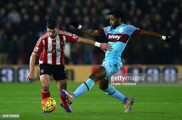 Shane Long of Southampton holds off Alexandre Song of West Ham United during the Barclays Premier League match between Southampton and West Ham...