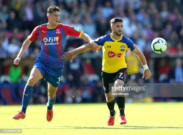 Shane Long of Southampton holds off Martin Kelly of Crystal Palace during the Premier League match between Crystal Palace and Southampton FC at...