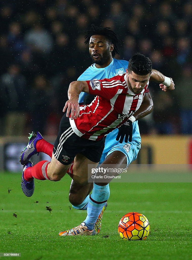 Shane Long of Southampton is challenged by Alexandre Song of West Ham United during the Barclays Premier League match between Southampton and West Ham United at St Mary's Stadium on February 6, 2016 in Southampton, England.