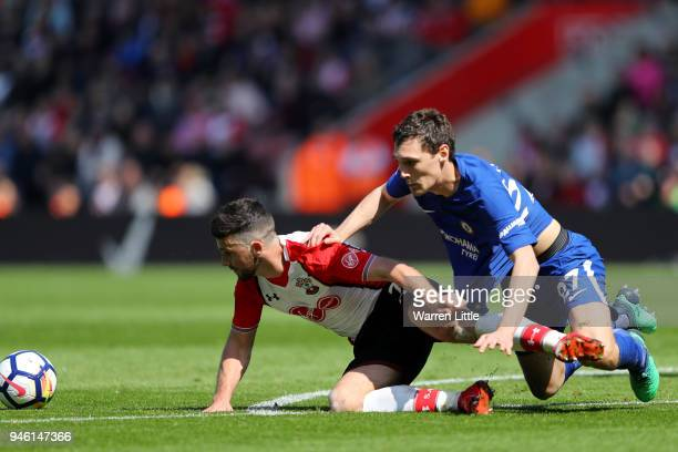 Shane Long of Southampton is challenged by Andreas Christensen of Chelsea during the Premier League match between Southampton and Chelsea at St...