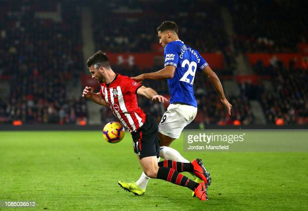 Shane Long of Southampton is challenged by Dominic CalvertLewin of Everton during the Premier League match between Southampton FC and Everton FC at...