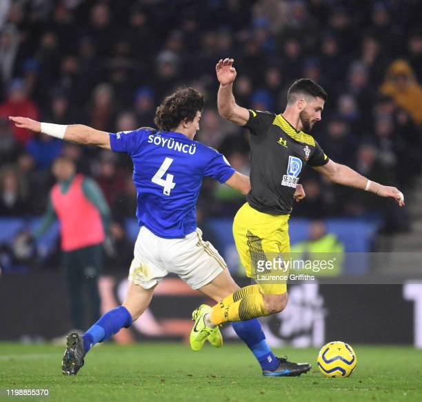 Shane Long of Southampton is fouled by Caglar Soyuncu of Leicester City resulting in a penalty which is overturned following a VAR review during the...