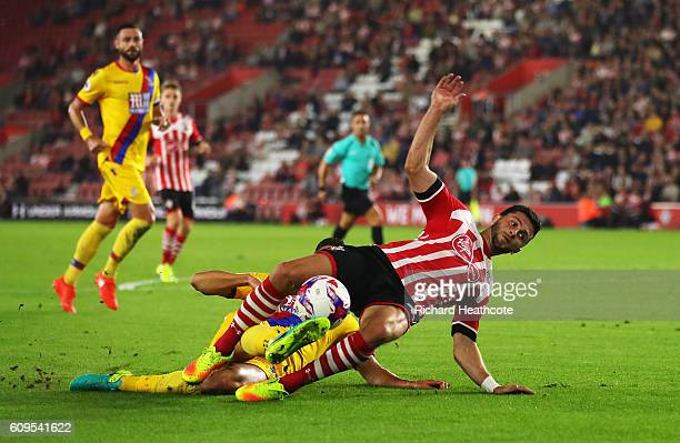 Shane Long of Southampton is fouled by Martin kelly of Crystal Palace inside the penalty area during the EFL Cup Third Round match between...