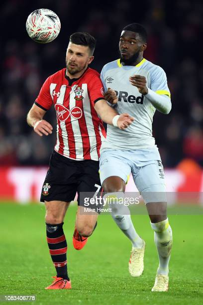 Shane Long of Southampton is tackled by Fikayo Tomori of Derby County during the FA Cup Third Round Replay match between Southampton FC and Derby...