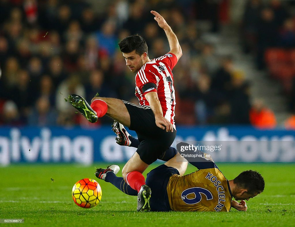 Shane Long of Southampton is tackled by Laurent Koscielny of Arsenal during the Barclays Premier League match between Southampton and Arsenal at St Mary's Stadium on December 26, 2015 in Southampton, England.