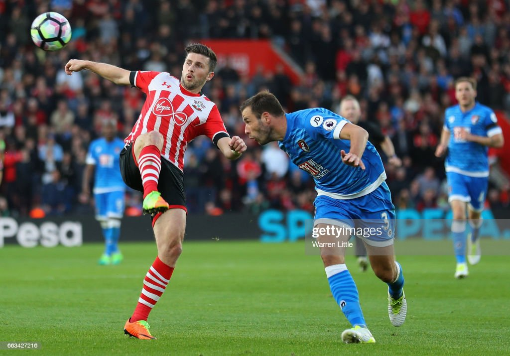 Shane Long of Southampton is tackled by Steve Cook of AFC Bournemouth during the Premier League match between Southampton and AFC Bournemouth at St Mary's Stadium on April 1, 2017 in Southampton, England.
