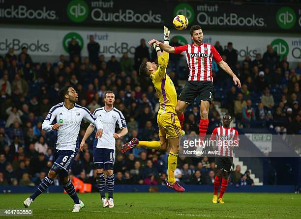 Shane Long of Southampton jumps with goalkeeper Ben Foster of West Bromwich Albion during the Barclays Premier League match between West Bromwich...
