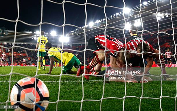 Shane Long of Southampton lies on the ground congratulated by team mates after scoring the opening goal during The Emirates FA Cup Third Round Replay...