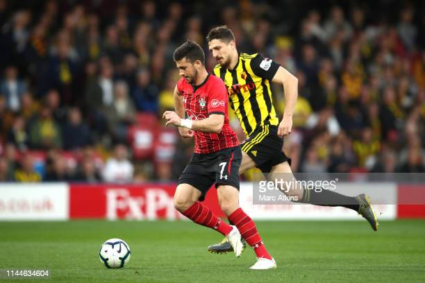 Shane Long of Southampton on his way to scoring his team's first goal during the Premier League match between Watford FC and Southampton FC at...
