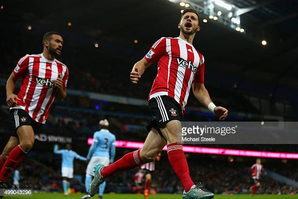Shane Long of Southampton scores his team's first goal during the Barclays Premier League match between Manchester City and Southampton at the Etihad...