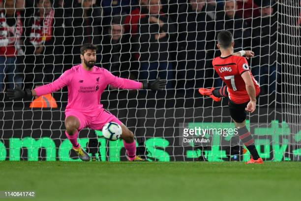 Shane Long of Southampton scores his team's first goal past Alisson of Liverpool during the Premier League match between Southampton FC and Liverpool...