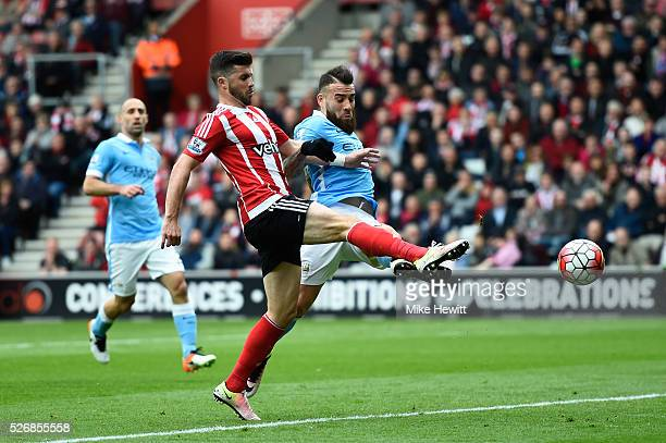 Shane Long of Southampton scores the opening goal during the Barclays Premier League match between Southampton and Manchester City at St Mary's...