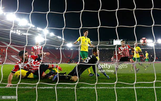 Shane Long of Southampton scores the opening goal during The Emirates FA Cup Third Round Replay match between Southampton and Norwich City at St...