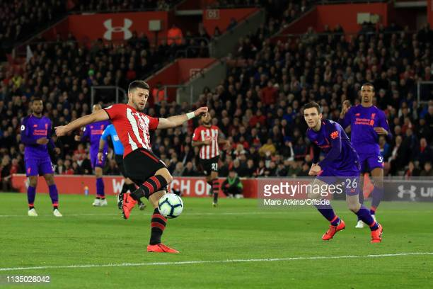 Shane Long of Southampton scores the opening goal during the Premier League match between Southampton FC and Liverpool FC at St Mary's Stadium on...